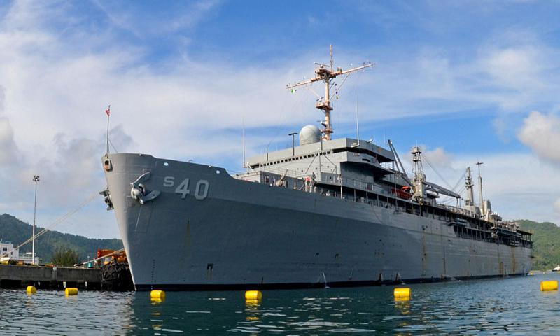 The submarine tender USS Frank Cable (AS 40) is moored in Sepangar Bay for a routine port visit. Frank Cable conducts maintenance and support of submarines and surface vessels deployed in the U.S. 7th Fleet area of responsibility. (U.S. Navy photo by Mass Communication Specialist 3rd Class Chris Salisbury/Released)