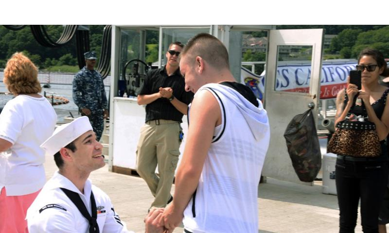 Petty Officer 2nd Class Jerrel Revels, left, proposes to his boyfriend Dylan Kirchner during the homecoming of the USS New Mexico at the submarine base in Groton, Conn., on Aug. 12, 2013, after the ship's inaugural six-month deployment. KRISTINA YOUNG/U.S. NAVY