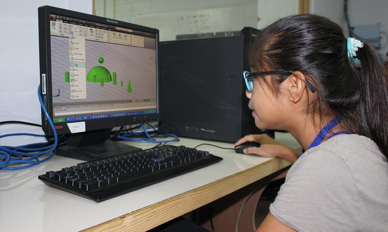 Stephenie Santos, 12, an 8th grader at Bishop Baumgartner School, creates a 3-D model in GCC's AutoCAD lab during the middle school National Transportation Summer Institute sponsored by GCC's College Access Challenge Grant Program. The institute introduces middle and high school students to careers in the transportation field.