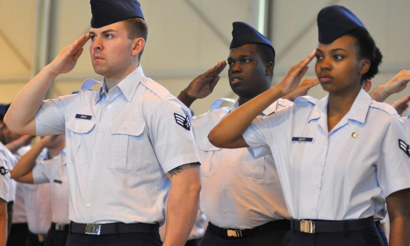 Airmen offer their salutes to 31st Fighter Wing leadership during a change of command ceremony at Aviano Air Base, Italy, Friday, June 10, 2016. With the Marines removing 'man' from some job titles, will airmen be called something else? 	 Kent Harris/Stars and Stripes