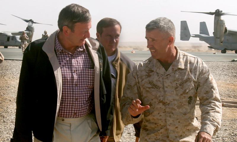 Then U.S. Ambassador to Afghanistan Karl Eikenberry walks through a forward operating base in Afghanistan with Col. Paul Kennedy, commanding officer of Regimental Combat Team-2, on Nov. 4, 2010.  1st Lt. Barry Morris/U.S. Marine Corps