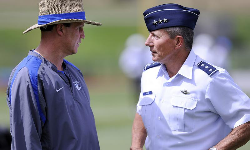 In an August, 2012 file photo, Air Force head football coach Troy Calhoun speaks to Lt. Gen Mike Gould, superintendent of the U.S. Air Force Academy, during practice.  Mike Kaplan/U.S. Air Force