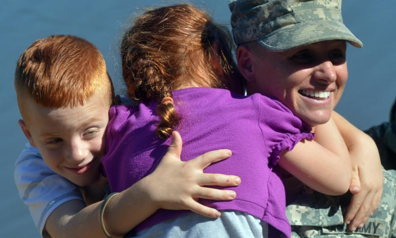 U.S. Army Maj. Lisa Jaster is congratulated by her children following graduation from Ranger School on Fort Benning, Ga., Oct. 16, 2015. Jaster is the third female to graduate Ranger School. Staff Sgt. Alex Manne/Army