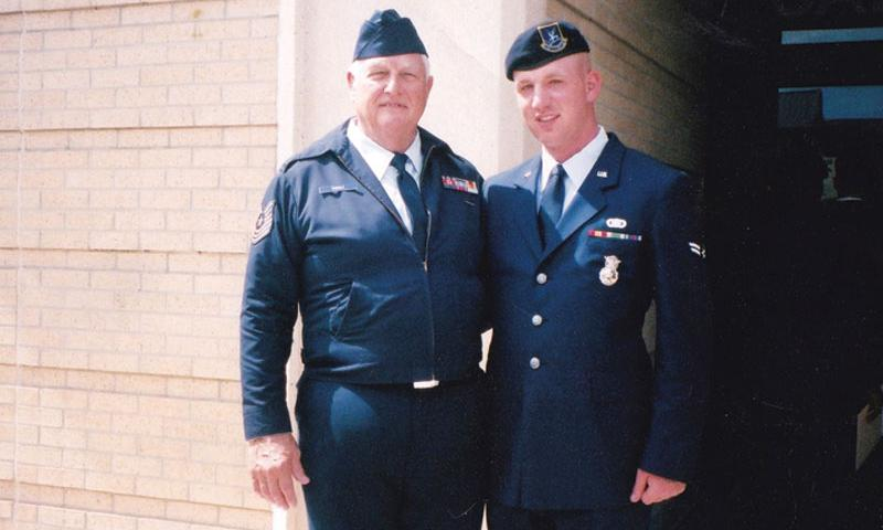 Retired Master Sgt. Tribble and A1C Robert Winters at Security Forces graduation in September 2002.