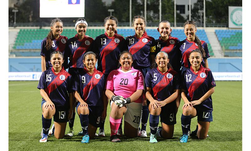 Guam's starting 11 players in the team's FIFA International Women's Friendly match against Singapore pose for a group photo ahead of the match at the Jalan Besar Stadium in Singapore Saturday evening. In the front row, kneeling, are from left to right: Hannah Cruz, Arisa Recella, Chyna Ramirez, Jinae Teria, and Skyylerblu Johnson. In the back row, standing, from left to right are: Abigail San Gil, Celine Doronila, Isabella Bass, Anjelica Perez, Sabrina Kenney, and Yae Kawauchi.