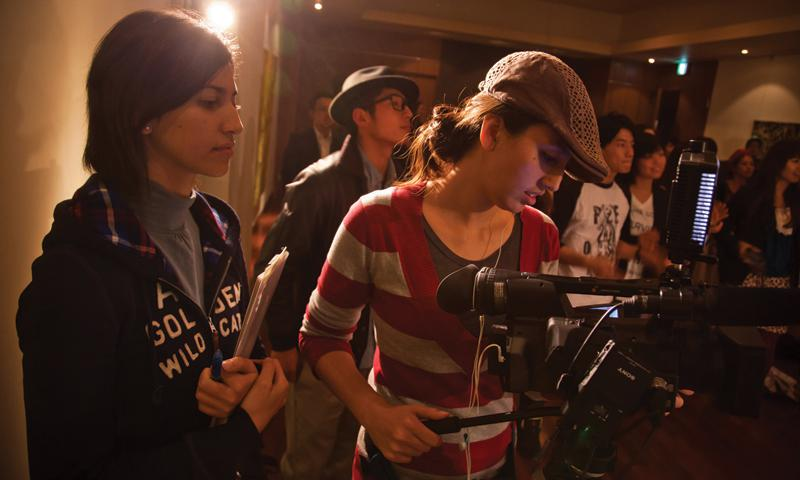 "Co-producers and co-directors Megumi Nishikura (right) and Lara Perez Takagi work on the set of ""Hafu – the Mixed-Race Experience of Japan."" Photo by Michael Connolly."