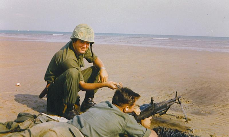 Marine Cpl. Gregory Harris, left, is seen here smiling as he feeds ammunition during training. Harris was declared missing following a 1966 ambush in Quang Ngai Province, South Vietnam. COURTESY OF HARRIS FAMILY