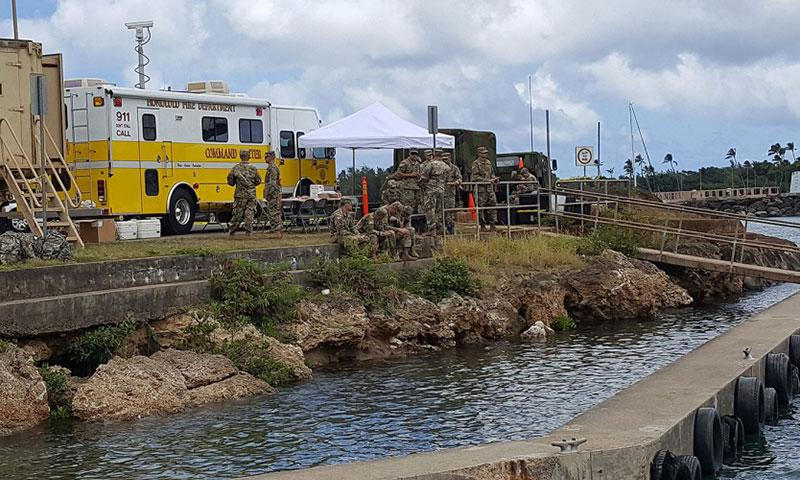 Military personnel gather at the search and rescue command center on Wednesday, Aug. 16, 2017 in Haleiwa, Hawaii. Rescue crews were searching for five soldiers who were aboard an Black Hawk helicopter that crashed several miles off Oahu's North Shore late Tuesday. WYATT OLSON/STARS AND STRIPES