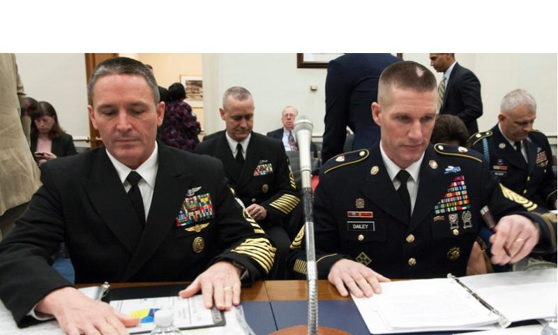 Master Chief Petty Officer of the Navy Michael D. Stephens, left, and Sgt. Maj. of the Army Daniel A. Dailey prepare for a hearing of the House Committee on Appropriations' Military Construction and Veterans Affairs Subcommittee on Capitol Hill, Feb. 25, 2015. Joe Gromelski/Stars and Stripes