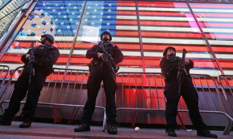 "Heavily armed New York city police officers with the Strategic Response Group stand guard at the armed forces recruiting center in New York's Times Square, Saturday, Nov. 14, 2015. Police in New York say they've deployed extra units to crowded areas of the city ""out of an abundance of caution"" in the wake of the attacks in Paris, France. A New York Police Department statement released Friday stressed police have ""no indication that the attack has any nexus to New York City.""   Mary Altaffer/AP"