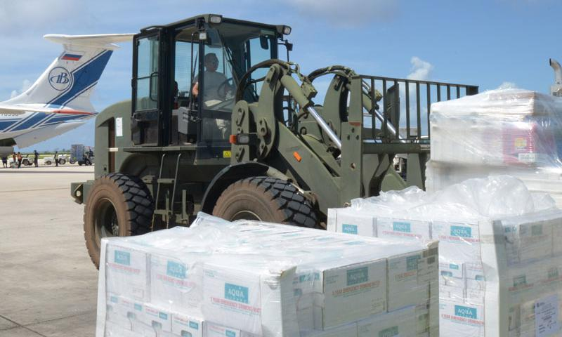 Senior Airman Louie Lacsina, 36th Mobility Response Squadron air transportation specialist and a native of Saipan, stages cases of water to be distributed to storm victims as part of Typhoon Soudelor relief efforts Aug. 12, 2015, on Saipan.  (U.S. Navy photo by Mass Communication Specialist 3rd Class Kristina D. Marshall)