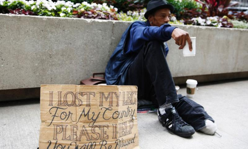A homeless veteran displays a redesigned cardboard sign in downtown Chicago on July 2, 2015.   Michael Noble Jr., Chicago Tribune/TNS
