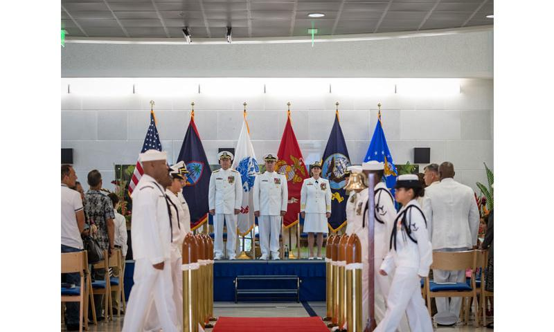 Rear Adm. Bruce L. Gillingham (left), Commander Navy Medicine West, Capt. Dan Cornwell (center), Commander U.S. Naval Hospital Guam (USNH Guam), and Capt. Jeannie Comlish (right), U.S. Navy Nurse Corps, prepare to exit the stage as the sideboys get ready to render honors for the departure of the official party. Cornwell relieved Comlish as commanding officer of USNH Guam in a change of command ceremony held June 30, 2016. Photo By Petty Officer 2nd Class Ryan Leverett