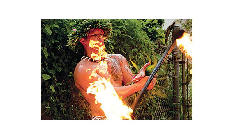 Christopher Santos practices with a fire stick before a recent performance in Tumon. Santos performs as a Polynesian fire-knife dancer during his spare time, pursuing his passion for dance.