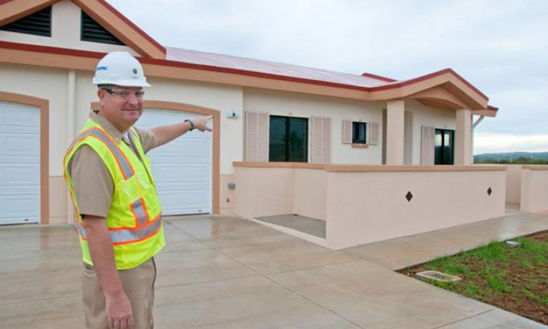 Lt. Cmdr. David Hubble, Naval Facilities Engineering Command (NAVFAC) Marianas director of Facilities Engineering and Acquisition Division, presents one of the 26 housing units that are nearing completion at North Tipalao on NBG Aug. 7. NAVFAC Marianas designed and executed the project with contractor Fed-Con which is expected to be completed in October. (U.S. Navy photo by Jesse Leon Guerrero)