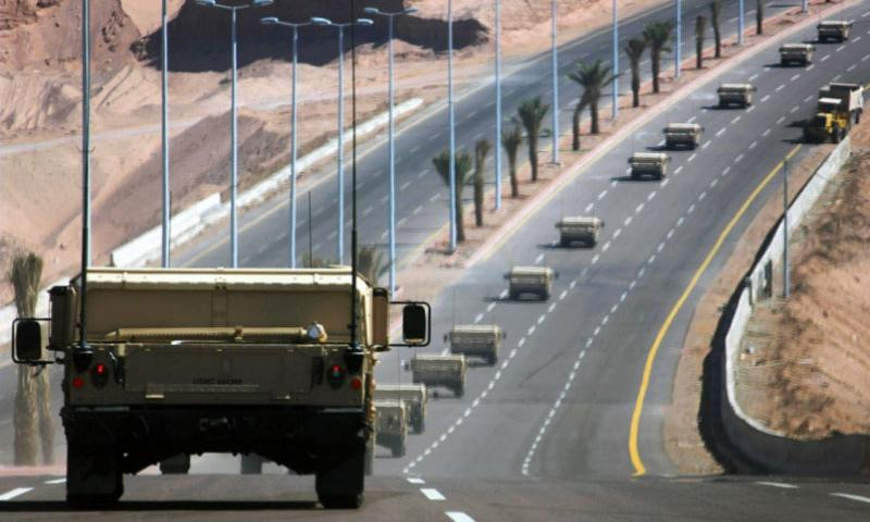Marines and sailors with the 24th Marine Expeditionary Unit drive Humvees toward Jordan after offloading from the USNS Sgt. William R. Button, a Maritime Prepositioning Fleet ship, on May 7, 2012.     Michael Petersheim/U.S. Marine Corps