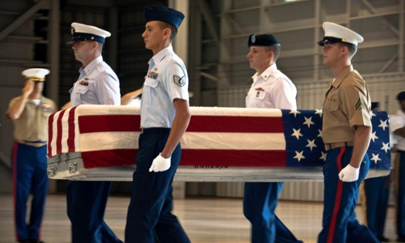 Servicemembers from various units under U.S. Pacific Command carry a remains transfer case during a repatriation ceremony on Nov. 30, 2012 on Joint Base Pearl Harbor Hickam.   Robert Bush/Courtesy of the U.S. Marine Corps