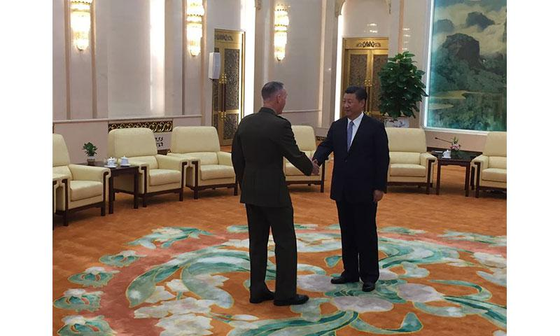 Marine Corps Gen. Joe Dunford, the chairman of the Joint Chiefs of Staff, meets Chinese President Xi Jinping in the Great Hall of the People at the conclusion of his visit to Beijing. DoD photo by Jim Garamone