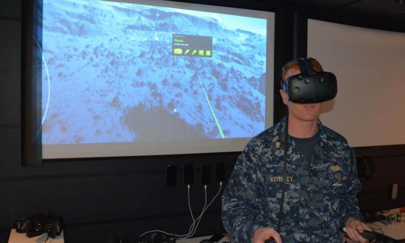 Lt. Cmdr. Christopher Keithley demonstrates a prototype that combines 3-D mapping of the ocean floor with virtual-reality goggles and handsets that could be used for submariner training. It is one of the ideas now in the pipeline at iLab, an innovation center at Joint Base Pearl Harbor-Hickam, Hawaii. WYATT OLSON/STARS AND STRIPES