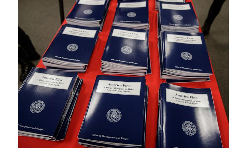 In this March 16, 2017 file photo, copies of President Donald Trump's first budget are displayed at the Government Printing Office in Washington.  J. SCOTT APPLEWHITE/AP