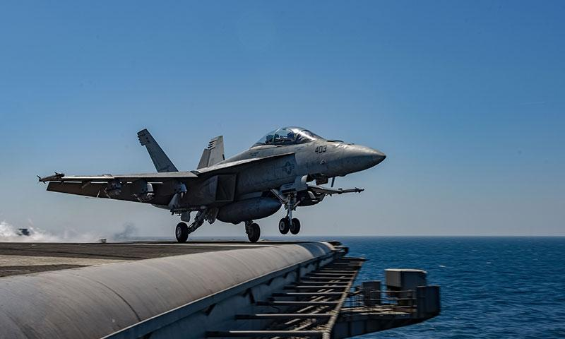 ARABIAN GULF (March 19, 2018) An F/A-18F Super Hornet assigned to the Mighty Shrikes of Strike Fighter Attack Squadron (VFA) 94 launches from the flight deck of the aircraft carrier USS Theodore Roosevelt (CVN 71). Theodore Roosevelt and its carrier strike group are deployed to the U.S. 5th Fleet area of operations in support of maritime security operations to reassure allies and partners and preserve the freedom of navigation and the free flow of commerce in the region. (Photo by MC3 Alex Perlman/Released)