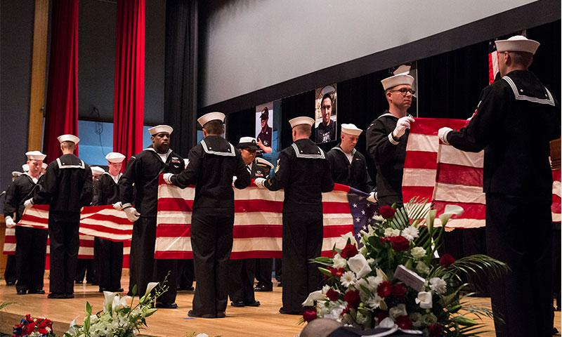 YOKOSUKA, Japan (June 27, 2017) Sailors fold seven American flags during a memorial ceremony at Fleet Activities Yokosuka honoring the seven Sailors assigned to the Arleigh Burke-class guided-missile destroyer USS Fitzgerald (DDG 62) who were killed in a collision at sea. (U.S. Navy photo by Mass Communication Specialist 2nd Class Raymond D. Diaz III/Released)