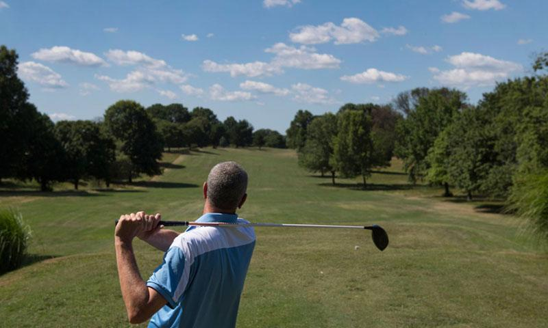 Golfers take to a green at Armed Forces Retirement Home in Washington. The grounds were established in 1851 for veterans. MATT MCCLAIN/WASHINGTON POST PHOTO