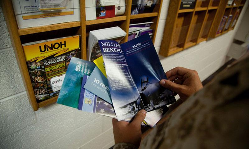 A Marine reads college pamphlets at the Education Center aboard Marine Corps Base Camp Lejeune, in this July 2013 photo. DONOVAN LEE/U.S. MARINE CORPS