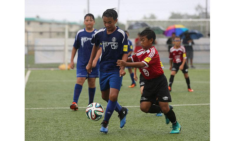 Guam Shipyard Wolverines' Nathan Toves and Wings Black's Riku Meyar fight for possession of the ball in a Week 6 match of the Aloha Maid Minetgot Cup Elite Youth League 2017 Spring season U13 division at the Guam Football Association National Training Center. The Fall season of the Minetgot Cup Elite Youth League's U13 division begins Aug. 19.