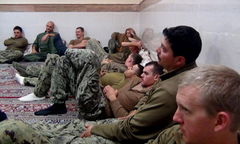 This picture released by the Iranian Revolutionary Guards on Wednesday, Jan. 13, 2016, shows detained American Navy sailors in an undisclosed location in Iran. All 10 of the sailors have been freed. Sepahnews/AP