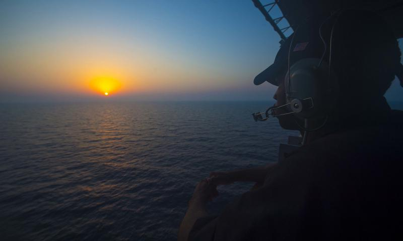 A U.S. sailor watches aboard the guided-missile cruiser USS Monterey on Aug. 30, 2016, while deployed as part of the Eisenhower Carrier Strike Group in the Persian Gulf. Navy assets in the region have seen an escalation of tensions with Iran. On Tuesday, Sept. 13, the Navy reported that Iran had threatened to fire on two U.S. Navy aircraft in three separate incidents last weekend. William Jenkins/U.S. Navy
