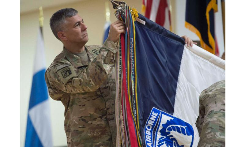 Lt. Gen. Stephen J. Townsend uncases the XVIII Airborne Corps colors during the transfer-of-authority ceremony of Combined Joint Task Force Operation Inherent Resolve, held at an undisclosed location in Southwest Asia, Aug. 21, 2016. Lt. Gen. Townsend and XVIII Airborne Corps took authority of the task force from Lt. Gen. Sean B. MacFarland and III Corps. The task force was created to defeat the Islamic State group in Iraq and Syria.  Chris Church/Stars and Stripes