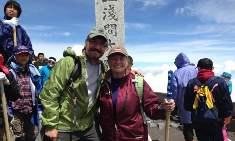 Jim and Marcia Hashman take time to smile at the summit of Mount Fuji in July 2013. The Hashmans climbed the mountain while Jim was battling early onset ALS. Due to his condition, Jim Hashman has applied for a disability retirement but it couldn't be processed because of the government shutdown, which left him and his wife stranded in Japan without specialists to treat the disease. COURTESY JIM HASHMAN