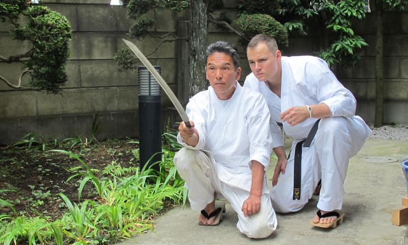Japanese sword master Masuki Ishii and Capt. Tom Raper eye the blade of a samurai sword at Ishii's home in Sagamihara, Japan. Photo by Takahiro Takiguchi
