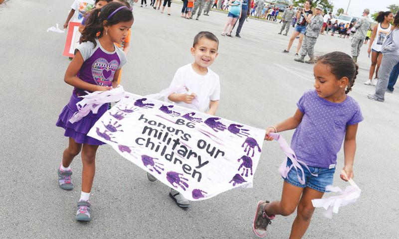 Children walk in a parade to celebrate the Month of the Military Child April 8 at Andersen Air Force Base.