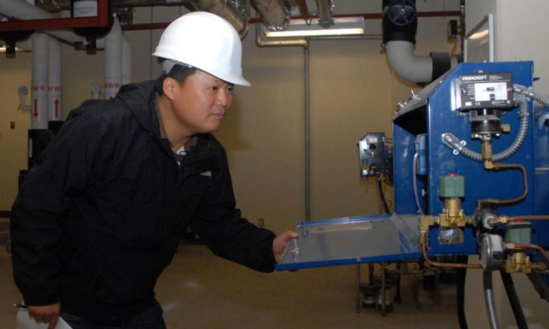 Kim Yong-Sik, then a U.S. Forces Korea employee, checks boiler room machinery at Kunsan Air Base, South Korea, Nov. 8, 2010. The U.S. recently eliminated a hardship differential allowance leading to a loss of income for nearly 3,000 Korea-based civilian employees.    Amanda Savannah/U.S. Air Force