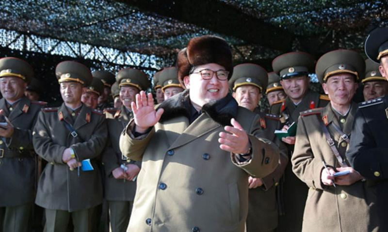 North Korean leader Kim Jong Un is flanked by his military leaders in this undated photograph from the Korean Central News Agency. On Tuesday, Mach 15, 2016, Un warned that his country soon would carry out another nuclear test and try out several types of ballistic missiles capable of carrying nuclear warheads.    Courtesy of KCNA