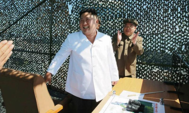 North Korean leader Kim Jong Un receives applause after an apparently successful test of a rocket engine in this photo published in the Tuesday, Sept. 20, 2016, edition of the official Rodong Sinmun newspaper. Courtesy of Rodong Sinmun