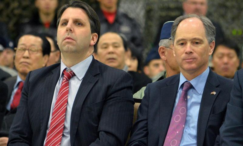 U.S. Ambassador Mark William Lippert, left, sits beside British Ambassador Scott Wightman during a change of a command ceremony at Osan Air Base, South Korea on Dec. 19, 2014. ARMANDO R. LIMON/STARS AND STRIPES