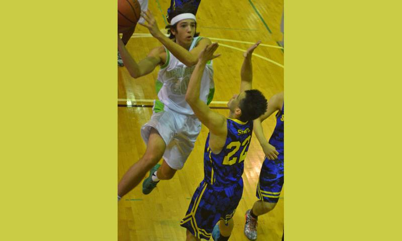 Kubasaki's Skylor Stevens goes up to shoot against St. Mary's Leo Stern during Saturday's inter-district boys basketball, won by the Dragons 70-63. Kubasaki concluded its three-game Tokyo road swing 2-1.  Dave Ornauer/Stars and Stripes
