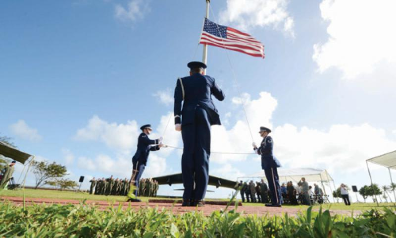 The Andersen Air Force Base honor guard lowers the flag to half-staff during the Operation Linebacker II Remembrance Ceremony at Andersen Air Force Base Dec. 14. U.S. Air Force photo by Senior Airman