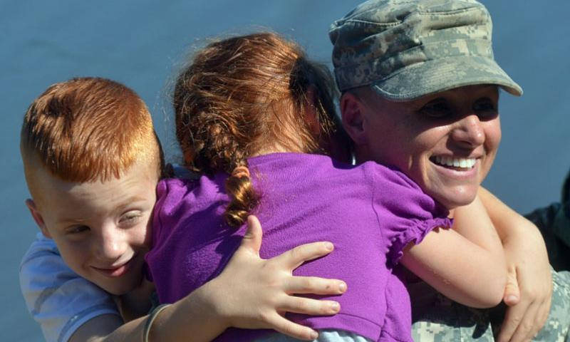 U.S. Army Maj. Lisa Jaster is congratulated by her children after graduating from the Army's Ranger School at Fort Benning, Ga., last October. She will be President Obama's guest at the upcoming State of the Union address.  Alex Manne/U.S. Army