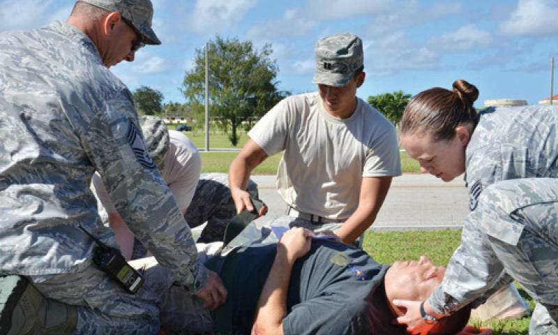 Airmen work together to treat a simulated injured patient during the Expeditionary Medical Support (EMEDS) Health Response Team (HRT) training on Andersen Air Force Base Dec. 12. U.S. Air Force photo by Staff Sgt. Alexandre Montes