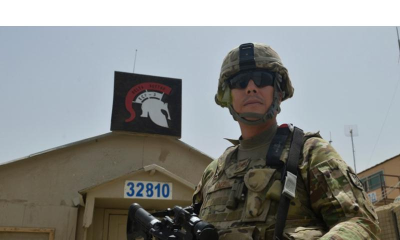 Air Force Staff Sgt. Jesus Yanezstands in front of his sector station at Bagram Airfield, Afghanistan July 2, 2014. Yanez has served in every branch of the military except for the Coast Guard. EVELYN CHAVEZ/U.S. AIR FORCE