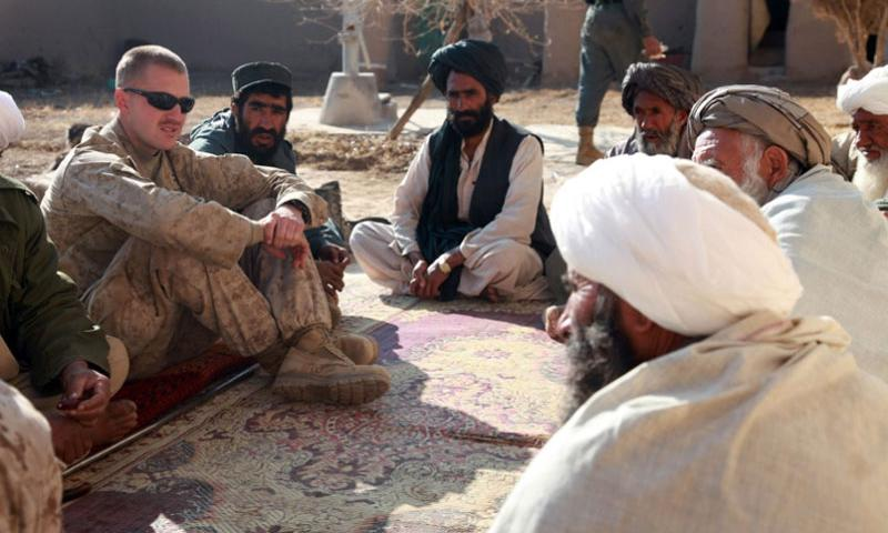 In this 2009 file photo, former Marine Corps Capt. Jason C. Brezler meets with Afghan leaders in Now Zad, Afghanistan.  Albert F. Hunt/U.S. Marine Corps