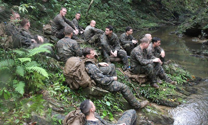 Company I Marines rest by a jungle stream during a break from jungle warfare training at the Jungle Warfare Training Center in northern Okinawa in March. The Marines came to Japan on a six-month rotation to learn to survive and fight in the jungle's harsh environment. Matthew M. Burke/Stars and Stripes