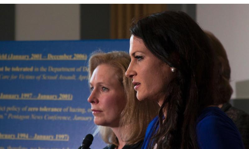 Ariana Klay, a former Marine officer and military sexual assault survivor, speaks in Washington, D.C. on Nov. 6, 2013, as Sen. Kirsten Gillibrand, D-NY, (background) looks on. Gillibrand is leading a bipartisan push calling for military sexual assault cases to be removed from the military chain of command. C.J. LIN/STARS AND STRIPES