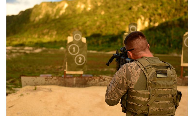 Staff Sgt. Stephen Horton fires an M4 carbine at a target July 7 at Andersen Air Force Base.