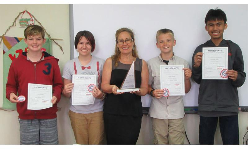 The Lester Middle School MATHCOUNTS Team placed 6th in the DoDEA state MATHCOUNTS competition held in locations around the world Mar. 24. (left to right) Nathan Hackel, Alexandria Gregory, coach Ms. Matthews-Soto, George Sample and Alexander Saber.