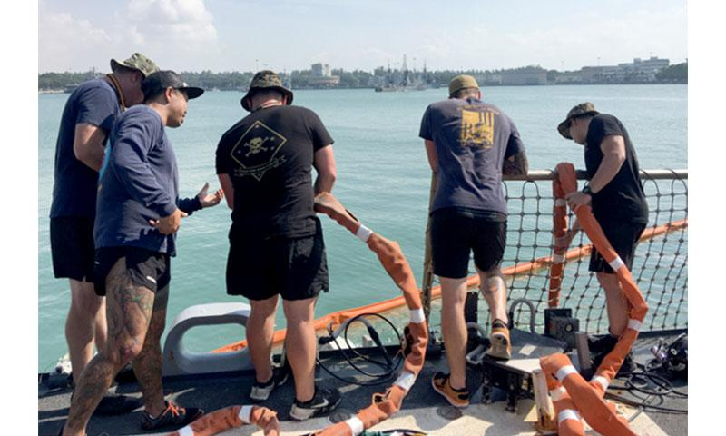 SINGAPORE (Aug. 23, 2017) A team of U.S. Navy and Marine Corps divers lower a tending line while conducting diving operations aboard the guided-missile destroyer USS John S. McCain (DDG 56) at Changi Naval Base in Singapore Aug. 23, 2017. John S. McCain sustained significant damage following a collision with the merchant vessel Alnic MC while underway east of the Strait of Malacca and Singapore on Aug. 21, 2017. (U.S. Navy photo by Master Chief Joshua Dumke/Released)